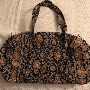 Vera Bradley duffle bag with matching makeup case.